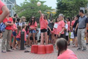 Teen Serve Campers celebrate their good work with games at Love Crushes Cancer. (Renss Greene/Loudoun Now)