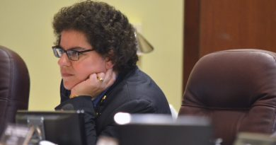 School Board member Joy Maloney (Broad Run) listens to a speaker at Aug. 9 board meeting. (Danielle Nadler/Loudoun Now)