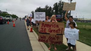 Protesters line up outside Briar Woods High School, waiting to great Donald Trump and his supporters.