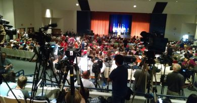 Trump supporters and media crowd into the auditorium at Briar Woods High School. (Renss Greene/Loudoun Now)