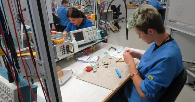 Katie Breza and her German host Melanie Eisele learn to solder components on a circuit board to build an LED cube in the Zollner training center in Zandt, Germany. Five Loudoun students traveled to Germany as part of George C. Marshall International Center's 2016 Marshalling-STEM pilot program.