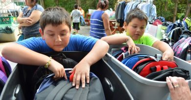 Brothers Chris and Joel, students at Sully Elementary School in Sterling, pick out backpacks at Mobile Hope on Thursday. [Danielle Nadler/Loudoun Now]