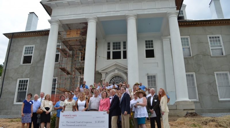 Some of the first guests to the Selma Mansion in years pose for a photo Monday. They gathered at the soon-to-be-restored house to celebrate the new Sharon D. Virts Foundation's first donation, a $10,000 grant to the Land Trust of Virginia. (Danielle Nadler/Loudoun Now)
