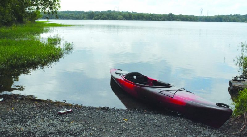 A kayak waits on the shoreline at Beaverdam Reservoir, which sits just off Belmont Ridge Road in Ashburn. The manmade body of water will be closed for two years, but promises to reopen as a more public friendly lake.  [Renss Greene/Loudoun Now]