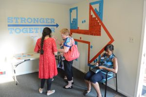 Volunteers sign up at the opening of the Clinton campaign's Leesburg field office. (Renss Greene/Loudoun Now)