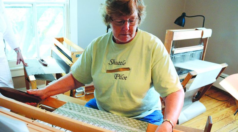 Linda George weaves at The Barefoot Weaver in Purcellville.  [Renss Greene/Loudoun Now]