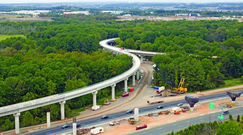 The elevated aerial guideway at the north end of Dulles International Airport will carry trains in to and out of the new rail maintenance yard.  [Jennifer T. Alcott, Capital Rail Constructors]
