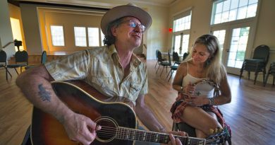 Janet Emma Garbe and Kevin Dudley, of Seven West, get a jam session in at the Old Waterford School in advance of their Sept. 9 show.  [Douglas Graham/Loudoun Now]