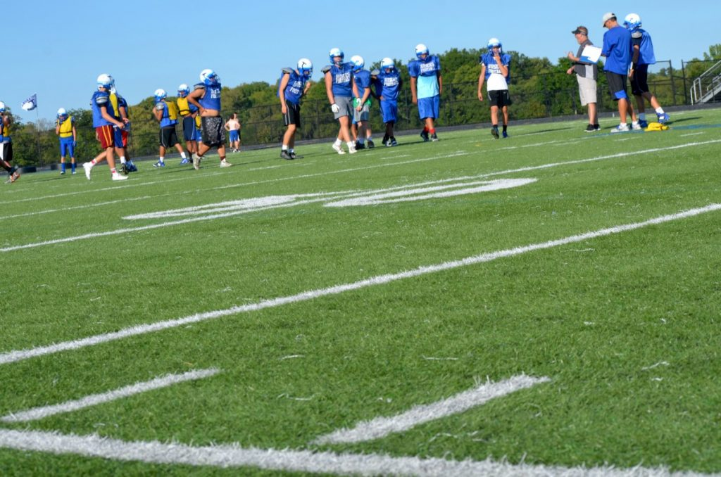 Freshmen practice football on Tuscarora High School's artificial turf field. [Danielle Nadler/Loudoun Now]