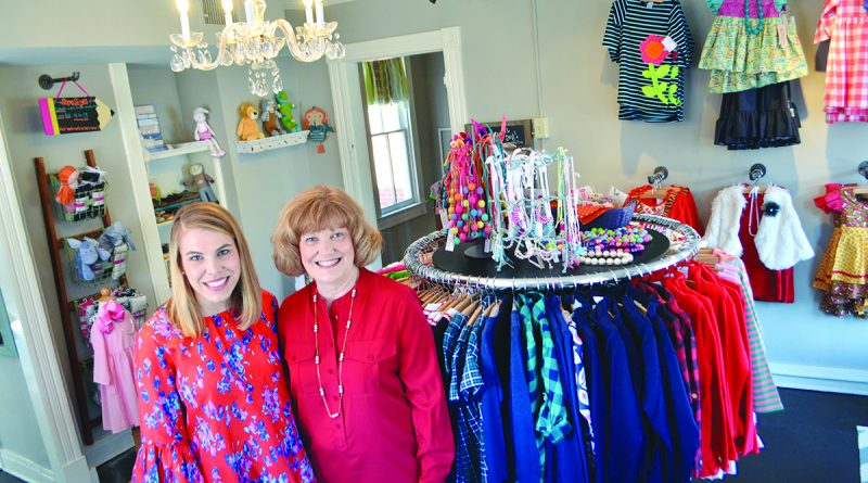 Debbie Thomas, right, and Kristine Smith brought their passion for children's clothing to their new Ashby Mae store in Leesburg.   [Danielle Nadler/Loudoun Now]