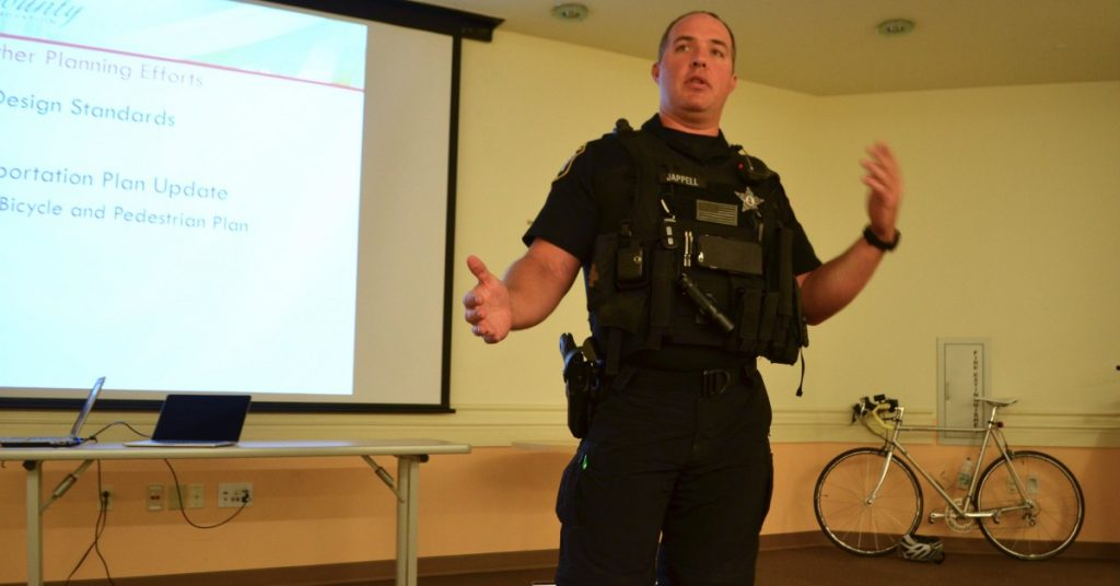 Deputy First Class Eddie Jappell, coordinator of Loudoun County Sheriff's Office's bike team speaks about cyclists' rights and responsibilities at the BikeLoudoun meeting. [Danielle Nadler/Loudoun Now]