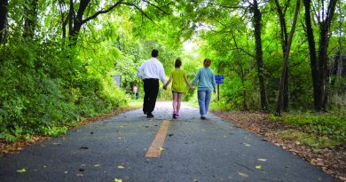 Nicole Clark walks along the W&OD Trail near Purcellville with her daughter, Jordan, and husband, Bill.  [Danielle Nadler/Loudoun Now]