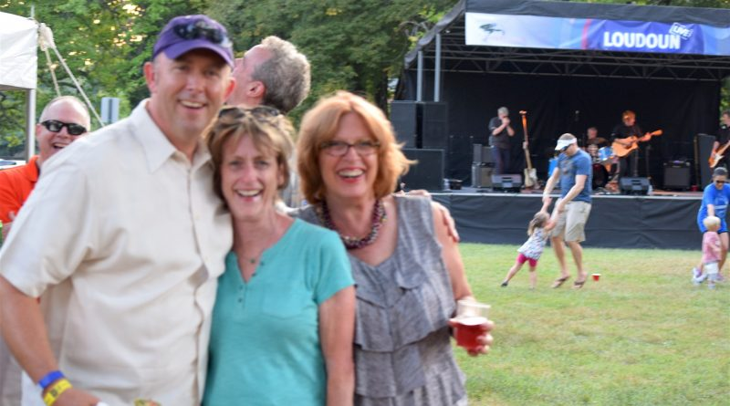 From left, Gary Clemens, Kelly Burk and Bobbi Elliot at the Loudoun Live concert.