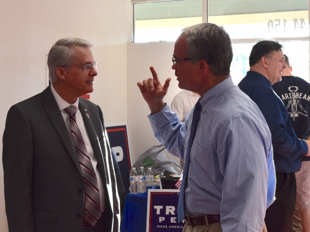 Sen. Dick Black, left, and Supervisor Geary Higgins talk during Tuesday's opening of a Republican campaign office in CountrySide.