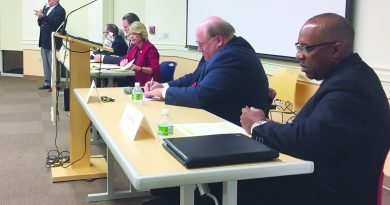 Ken Reid, left, speaks during the Sept. 22 voters forum as Ron Campbell, right, and other Town Council candidates look on.