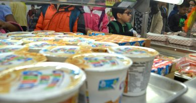 Students at Frederick Douglass Elementary School in Leesburg line up for breakfast. In their effort to keep up with the growing number of students with allergies, Loudoun's schools introduced signs that let students know whether dishes contain any of the most common allergens. [Danielle Nadler/Loudoun Now]