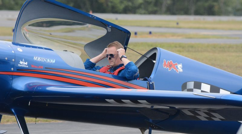 Scott Francis gets belted into his MXS stunt plane. (Renss Greene/Loudoun Now)
