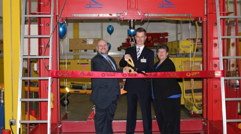Department of Economic Development Director Buddy Rizer, Hydro Systems executive Jon Edwards, and Supervisor Suzanne M. Volpe (R-Algonkian) cut the ribbon on a new facility March 16.  [Loudoun Department of Economic Development]