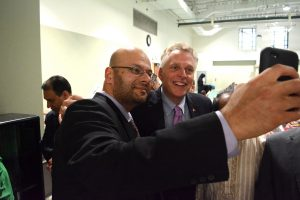ADAMS Board of Trustees Chairman Rizwan Jaka grabs a selfie with Governor Terry McAuliffe (D). (Renss Greene/Loudoun Now)