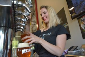 Elizabeth Kappel pulls pints at Beltway Brewing Company's third anniversary celebration. (Renss Greene/Loudoun Now)
