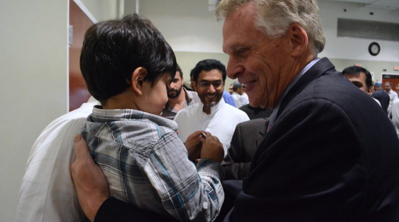 Governor Terry McAuliffe (D) meets a young attendee of Friday prayers at the ADAMS Center in Sterling. (Renss Greene/Loudoun Now)