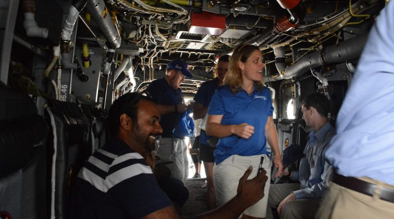 Visitors tour the inside of a U.S. Marine Corps V-22 Osprey. (Renss Greene/Loudoun Now)