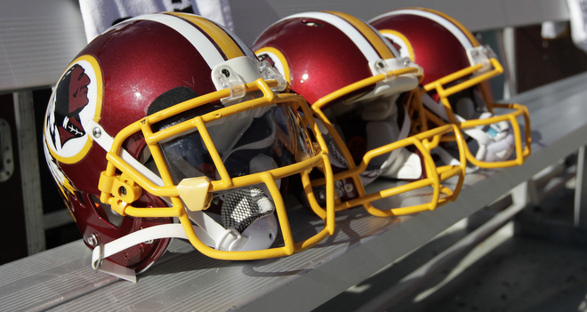 Washington Redskins quarterbacks' helmets are seen on the bench before an NFL football game against the Miami Dolphins Sunday, Sept. 13, 2015, in Landover, Md. (AP Photo/Mark Tenally)
