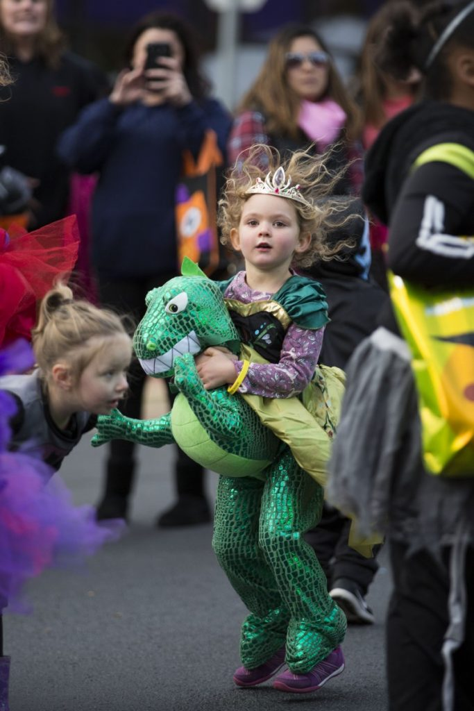 Arabella, age 4, gets her groove on, even in her heavy dinosaur costume. [Ali Khaligh/Loudoun Now]