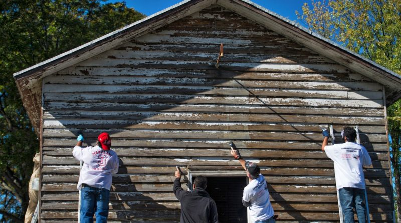 Hundreds of volunteers lent a hand at the Community Restoration Celebration at the Ashburn Colored School on Sunday. [Douglas Graham/Loudoun Now]