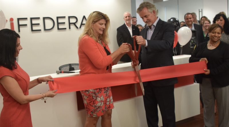 FCi Federal Founder and Chairman Sharon Virts and President and CEO Scott F. Miller cut the ribbon for new office space in Ashburn.i