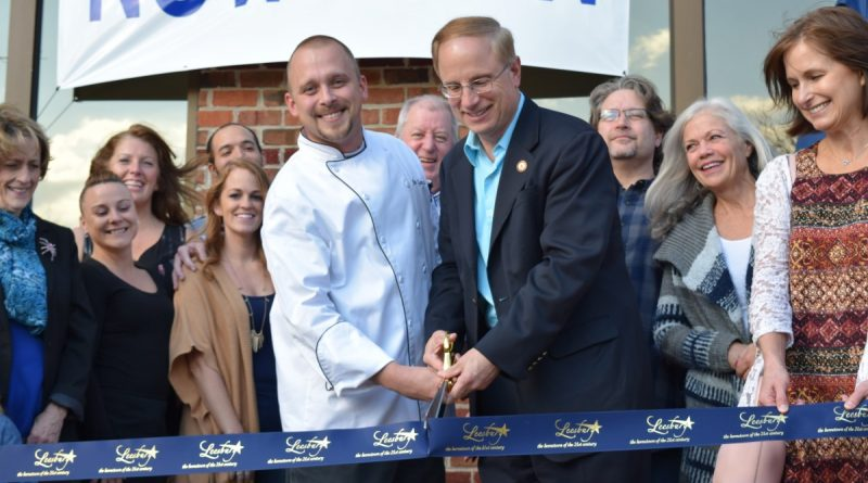 Chef Joe Ganzer and Mayor Dave Butler lead the Oct. 24 ribbon-cutting at Dog Money Restaurant & Brewery on Catoctin Circle. (Norman K. Styer/Loudoun Now)