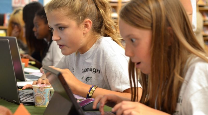 Middle school students Bella, left, and Emma create their own Frogger arcade game during Foxcroft School's Jump into Game Design event. [Danielle Nadler/Loudoun Now]