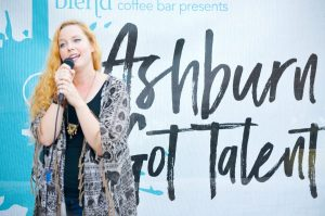 Christi McCarthy belts a Sara Bareilles song at the Ashburn's Got Talent audition Sept. 22. She was one of more than 20 people to showcase their talents during three evening auditions. [Danielle Nadler/Loudoun Now]