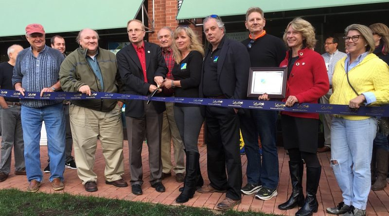 Ralph Ferraiolo and his wife Leann Micheals where joined by town leaders and a crowd of Ferraiolo Fitness clients Saturday afternoon for a formal ribbon cutting ceremony.