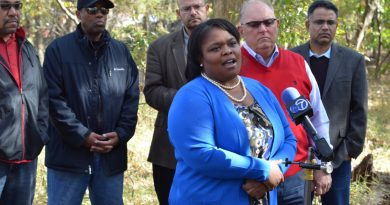 Pastor Michelle C. Thomas, of Holy & Whole Life Changing Ministries, leads a press conference at the cemetery site just off Belmont Ridge Road. [Danielle Nadler/Loudoun Now]