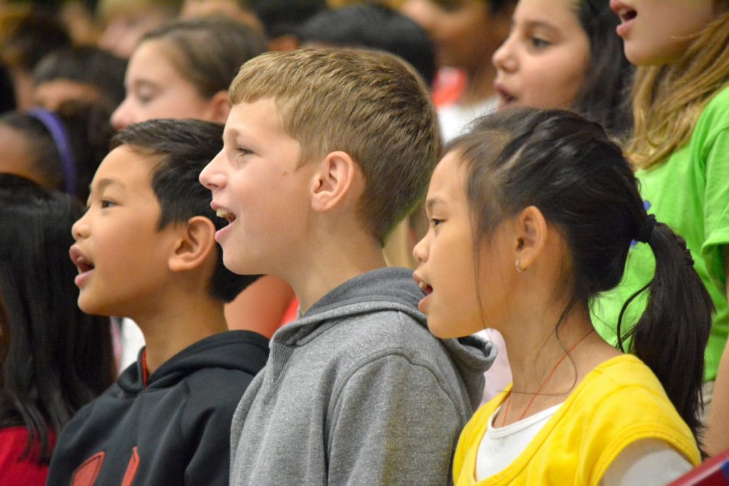 Madison's Trust Elementary School students perform at the school's dedication Friday. [Danielle Nadler/Loudoun Now]