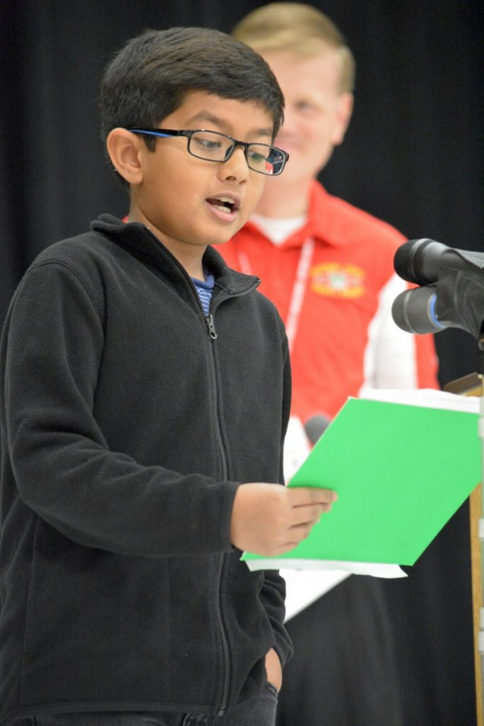 Fifth-grader Shreyas Sailesh takes his turn at the mic during Madison's Trust Elementary's dedication ceremony. [Danielle Nadler/Loudoun Now]