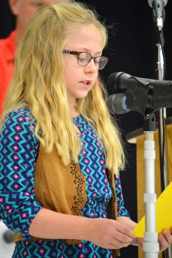 Third-grader Addison Holland reads a statement during Madison's Trust Elementary's dedication ceremony. [Danielle Nadler/Loudoun Now]