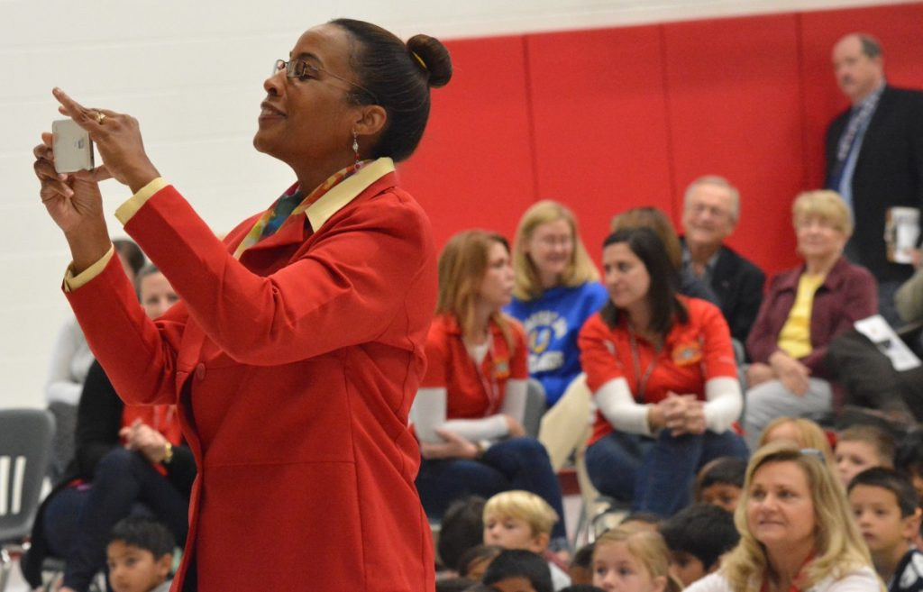 County Chairwoman Phyllis J. Randall (D-At Large) snaps photos of student performers. [Danielle Nadler/Loudoun Now]