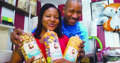 Popcorn Monkey owners Mickey and Deltone Moore pose for a photo in their new location in downtown Middleburg.  (Photo by Douglas Graham/Loudoun Now)