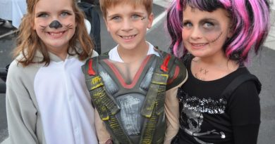 Triplets Morgan, Landon and Haydon pose for a photo at the Purcellville Halloween Block Party. [Danielle Nadler/Loudoun Now]