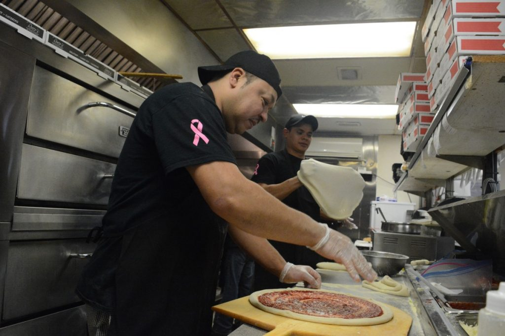 José Benitas and Fabrizio Martinez make pizzas at Rocco's. [Renss Greene/Loudoun Now]
