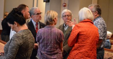 Supervisors Tony R. Buffington Jr. (R-Blue Ridge) and Geary M. Higgins (R-Catoctin) talk with public hearing speakers at the Oct. 12 meeting. (Renss Greene/Loudoun Now)
