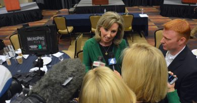 Republican Congresswoman Barbara Comstock talks to TV reporters after the debate against her Democratic challenger LuAnn Bennett. Comstock has urged Donald J. Trump to drop out of the presidential race. (Renss Greene/Loudoun Now)