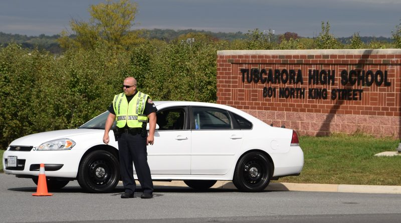 The Leesburg Police Department blocked the entrance of Tuscarora High School on Thursday afternoon as the school was evacuated to investigate a bomb threat. [Norman K. Styer/Loudoun Now]