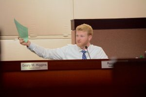 Supervisor Ron A. Meyer Jr. (R-Broad Run) waves a copy of the ADAMS parking plan at the board meeting Thursday, October 20. (Renss Greene/Loudoun Now)