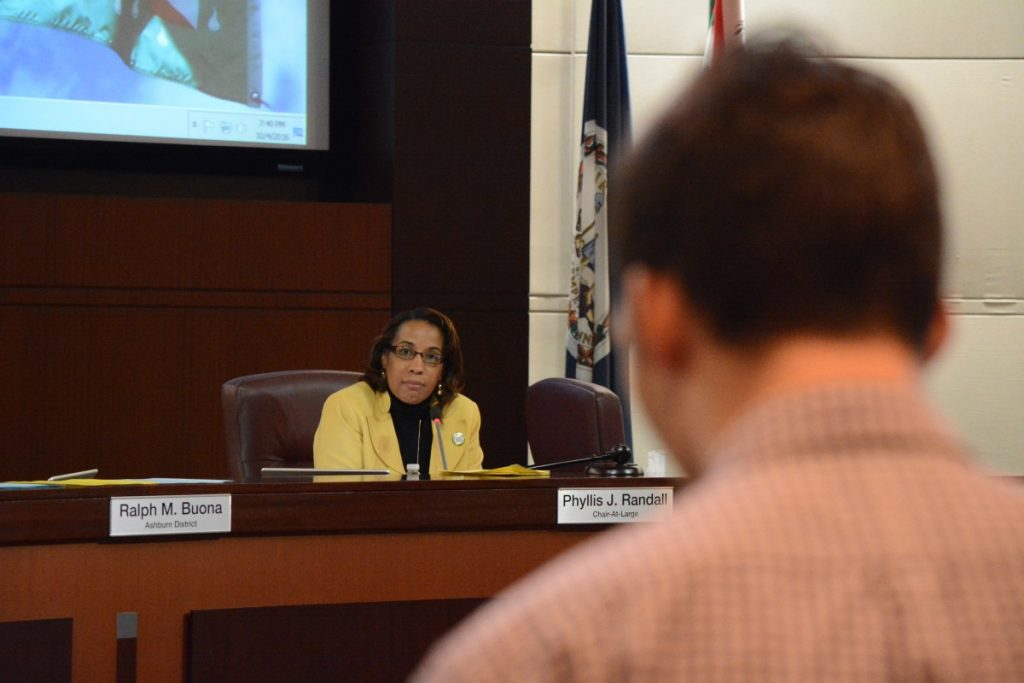 Chairwoman Phyllis J. Randall (D-At Large) listens to Alex Burns. (Renss Greene/Loudoun Now)