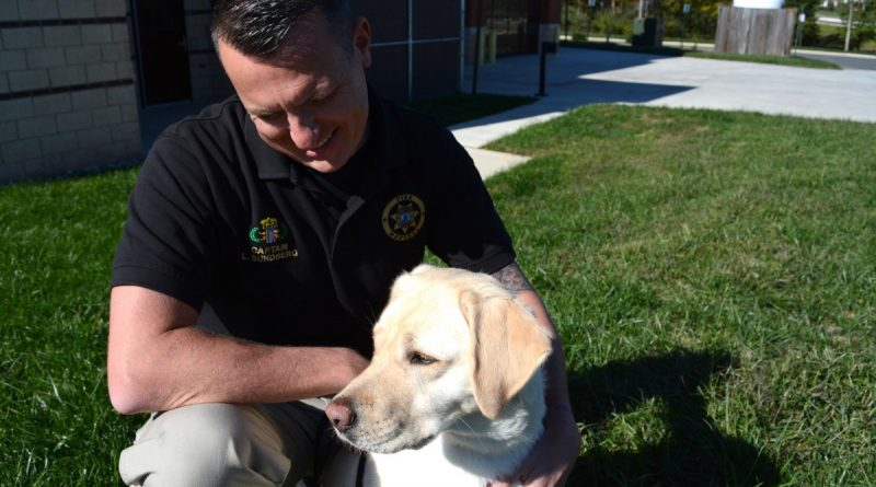Fire Marshall's Office Captain Leif Sundberg and Aurora, currently the county's only bomb sniffing dog. (Renss Greene/Loudoun Now)