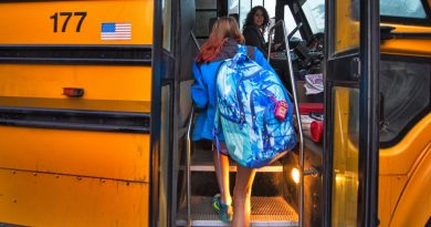 Bus driver Michelle Coates greets Harmony Middle School student McKenna Ill just after 7 a.m. Monday. The county school system faces a severe driver shortage, with as many as 95 vacancies. [Douglas Graham/Loudoun Now]