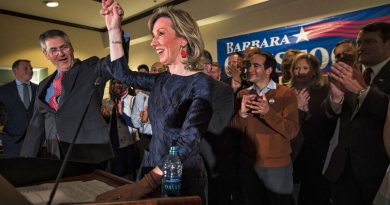 Elwyn Charles Comstock (L) the husband of Barbara Comstock, R-VA., holds her hand high in victory after she announced she had won her Congressional seat for Virginia. (Douglas Graham/Loudoun Now)